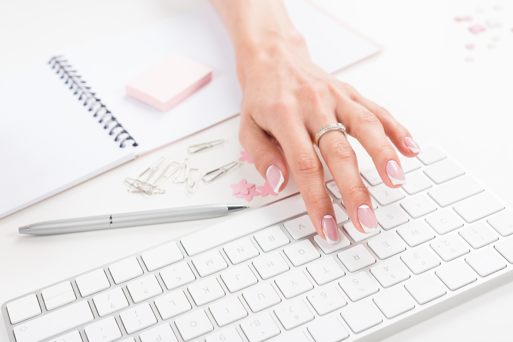 Email marketing copywriter and strategist typing on a keyboard.